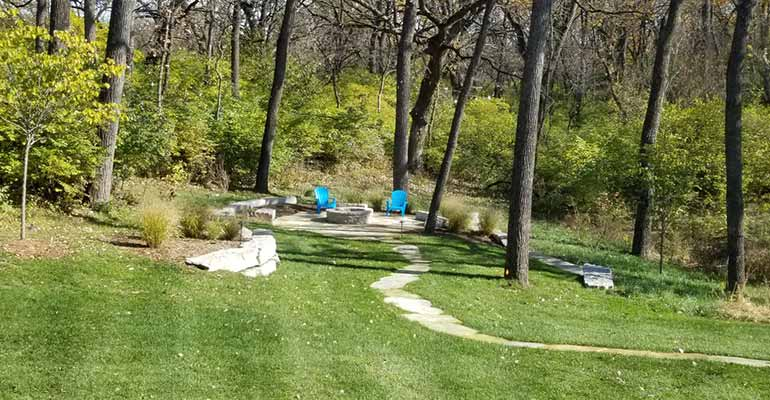 A well maintained Granger, IA back yard with lawn care services.