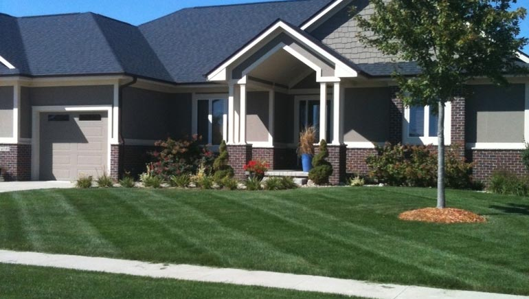 A professionally maintained lawn and landscape at a home in Clive, Iowa.
