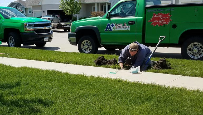 One of our irrigation specialists making repairs to a irrigation system at a home in Ankeny.