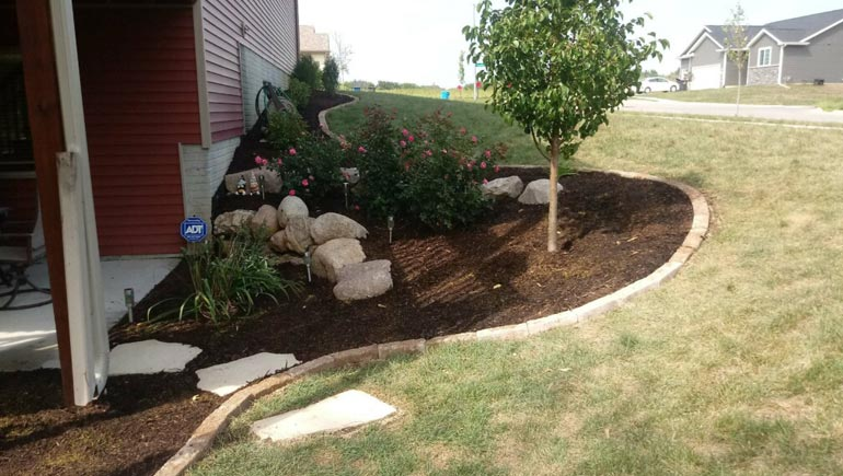 Softscape design and installed by our team at a home in Urbandale, Iowa.
