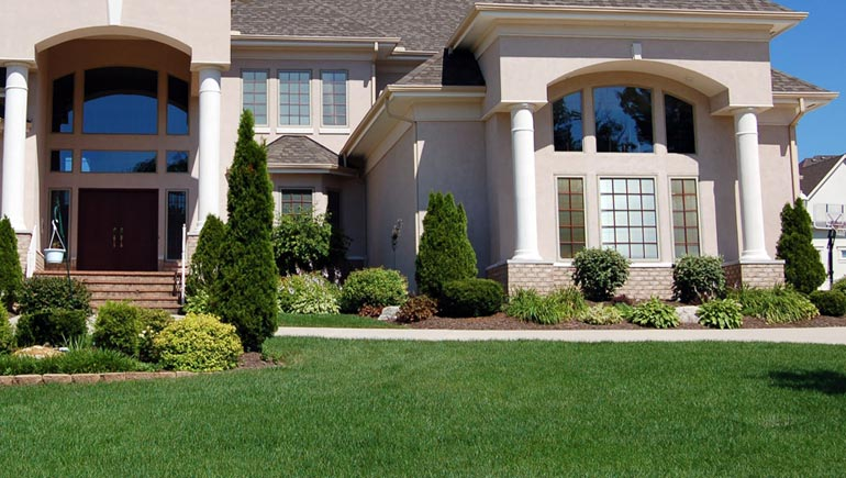 A professionally maintained lawn and landscape at a home in Grimes, Iowa.