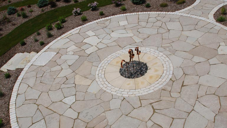 Flagstone patio with fire pit installed at a home in Norwalk, Iowa.
