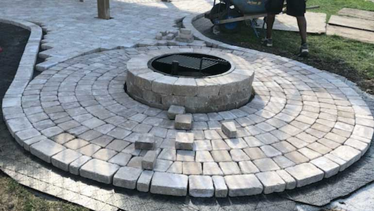 Paver patio and fire pit construction at a Des Moines, IA home.