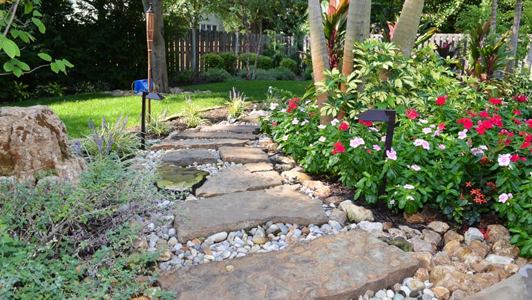 Beautiful stone pathway with a newly planted softscape at a home in Windsor Heights, Iowa.