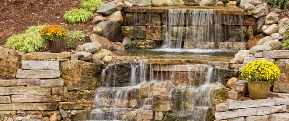Custom waterfall landscaping feature installed at a Carlisle, IA home.
