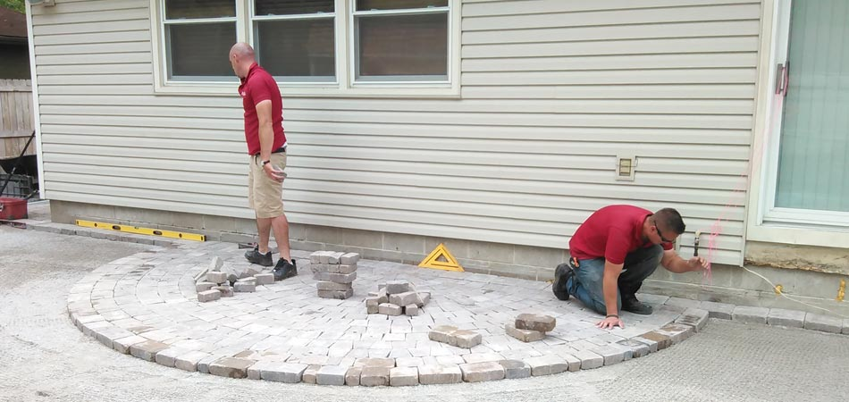 Our team building a new pave patio in the backyard of a home in Waukee, Iowa.