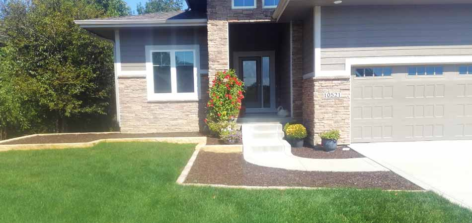 Property in Des Moines benefiting from ongoing lawn maintenance services.