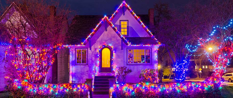 Colorful holiday lighting installed on a home in  West Des Moines, IA.
