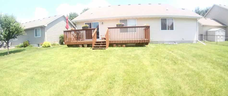 Freshly mowed and maintained home lawn in Carlisle, IA.