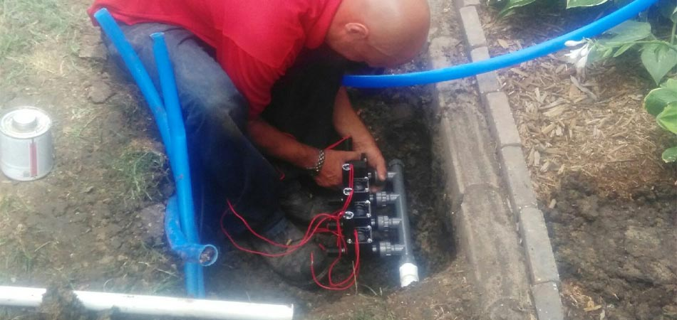 One of our expert lawn technicians installing a new irrigation system.