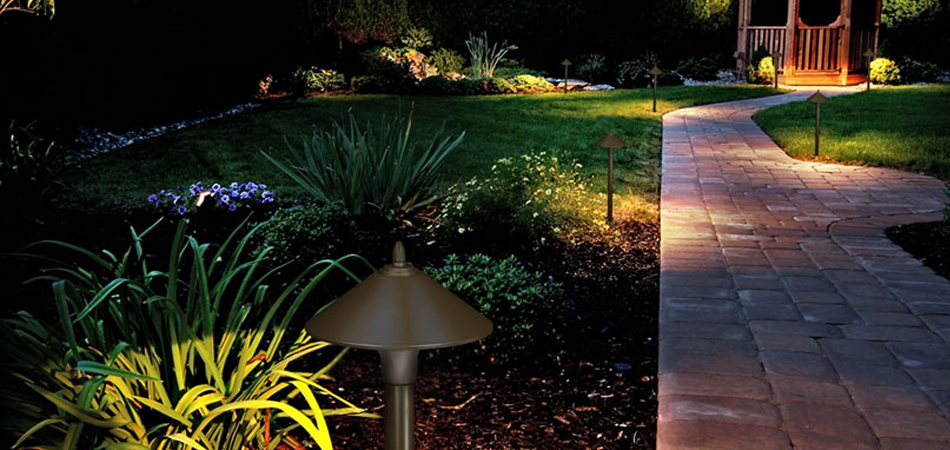 Outdoor lighting by a walkway in Des Moines, IA.