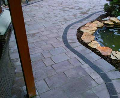 Custom paver patio and walkway construction in West Des Moines, IA.