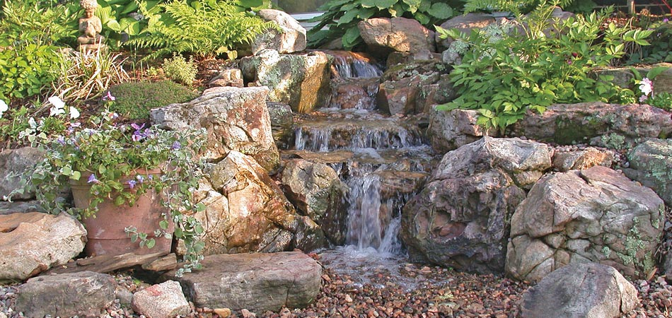 A rock waterfall that we regularly maintain and treat the water.