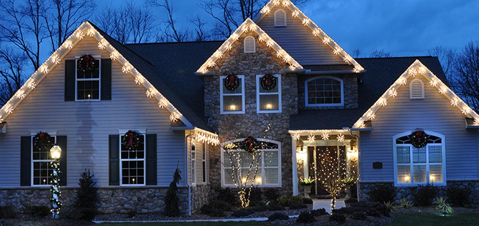 Homeowner in Des Moines with holiday lighting displays by A+ Lawn & Landscape.