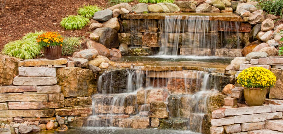 Rock waterfall and landscaping that was recently installed in the backyard of a home in West Des Moines, IA.