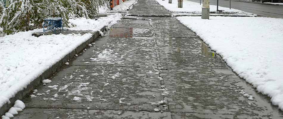 Sidewalk in Des Moines, IA after deicing services performed.