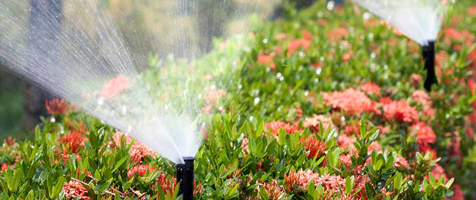 Sprinkler irrigation system water flowers at a Granger, IA home.