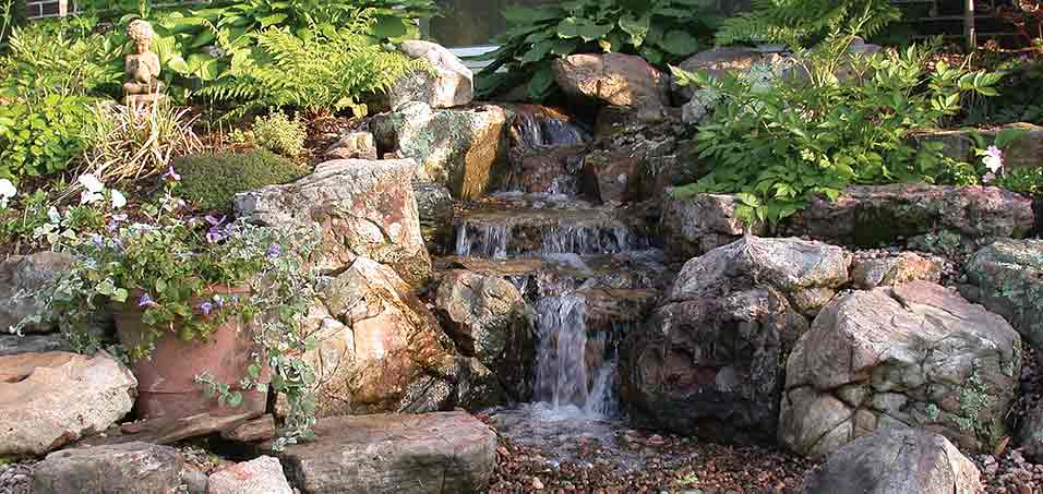 A well-designed waterfall that was perfectly integrated into this Ankeny property.