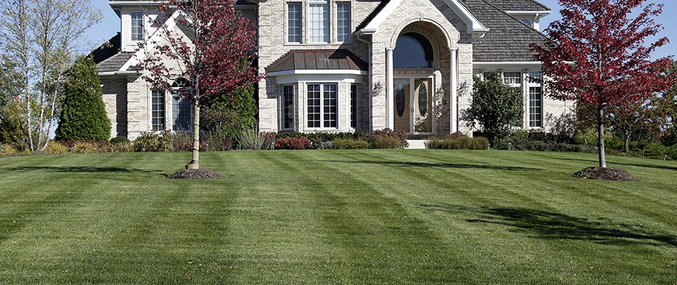 A home with regular lawn mowing and maintenance in Adel, IA.